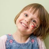 Little girl with flower face paint Royalty Free Stock Images