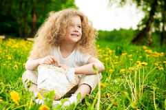 Little girl on flower field Royalty Free Stock Photos