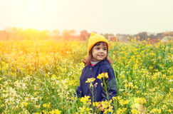Little girl flower field. Little girl walking on the flower field Stock Image
