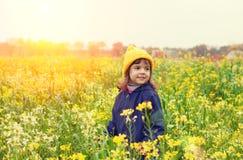 Little girl flower field Stock Image