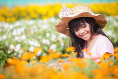 Little girl on flower filed Stock Photo