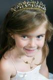 Little girl in flower-girl wear. Cute girl wearing a tiara and flower-girl dress - studio portrait Stock Photos