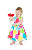 Little girl with a flower in hands royalty free stock images