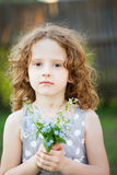Little girl with a flower in her hand. Mothers day concept. Stock Photos