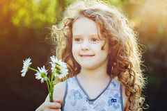 Little girl with a flower in her hand. Mothers day concept. Royalty Free Stock Photos