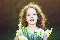 Little girl with a flower in her hand. Mothers day concept. Royalty Free Stock Photography