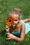 Little girl with a flower. In summer time Stock Photo