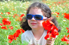 Little girl and flowers. Little girl on the meadow Stock Images