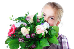 Little girl with flowers. Little girl behind a flower bouquet Royalty Free Stock Photos