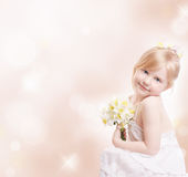Little girl with flowers. Little beautiful  girl with flowers Royalty Free Stock Images