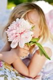 Little girl with flowers Royalty Free Stock Photo