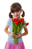 Little girl with flowers Royalty Free Stock Images