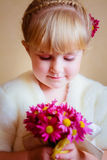 Little Girl With Flowers Asters In Their Hands Stock Images