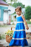 Little girl with flowers in basket royalty free stock images