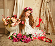 Little girl with flowers Stock Photo