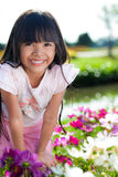 Little girl with Flowers field Royalty Free Stock Photography