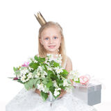 Little girl with flowers over white Royalty Free Stock Photography