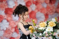 Little girl with flowers Stock Photos