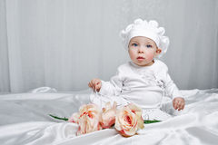 Little girl and flowers Royalty Free Stock Photography