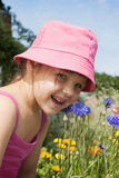A little girl in a meadow royalty free stock image