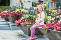 Little girl  in flowers. Little girl with tresses in flowers Royalty Free Stock Photography