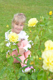 Little girl in the flowers Royalty Free Stock Photo