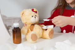 Little girl with flu, cold or fever at home Stock Photo