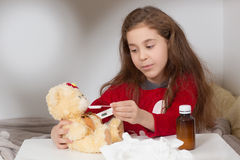 Little girl with flu, cold or fever at home Stock Photos