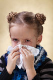 Little girl with the flu - blowing nose Royalty Free Stock Photography