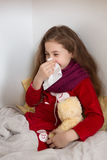 Little girl with flu at home Stock Photos