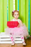 Little girl in fluffy skirts with gift box Royalty Free Stock Photography