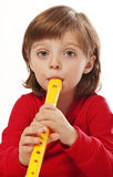 Little girl with  flute Stock Image