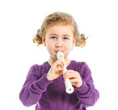 Little girl with  flute Stock Photography
