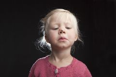Little girl with fly on her nose Stock Photos