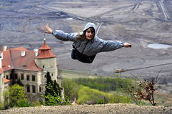 Little girl flying. The little girl flying above the Chateau Jezeri stock images