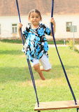 Little girl flying above a swing Royalty Free Stock Images