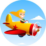 Little girl flying an airplane Royalty Free Stock Images