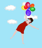 Little girl flying with the balloons Stock Photos