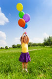 Little girl with flying balloons in the air Royalty Free Stock Images