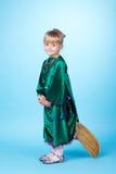 Little girl flying on broom Stock Photos
