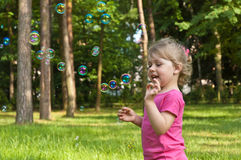 Little girl flying bubble Royalty Free Stock Photos