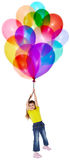 Little girl is flying on bunch of balloons Royalty Free Stock Photo