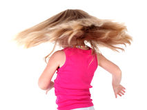 Little girl with flying hairs Stock Photos