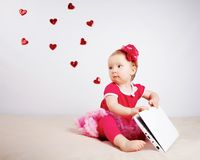 Little girl with flying hearts in studio Stock Images