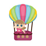 Little girl flying in a hot air balloon. Royalty Free Stock Photo