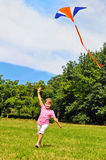 Little girl flying a kite Stock Image