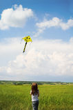 Little girl with flying a kite Royalty Free Stock Images