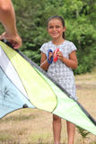 Little girl flying kite Stock Photography