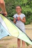 Little girl flying kite Stock Photography