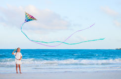 Little girl flying a kite Stock Image